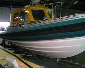 Pilot vessel requiring a rubber fender replacement